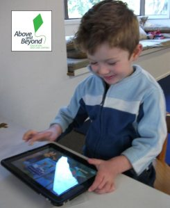 Child using iPad.
